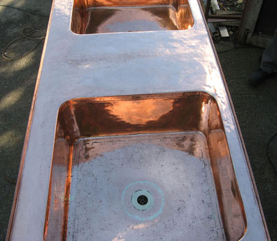 A reconstructed genuine antique double copper basin