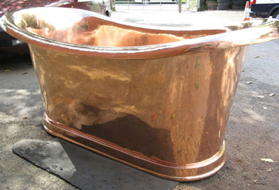 A reconstructed genuine antique roll top copper bath